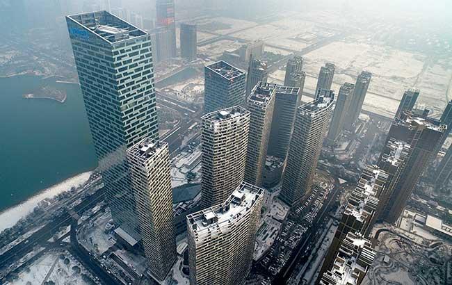 新華網安徽航拍:第一縷陽光下的雪中合肥